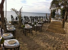 Beach ceremony--I love the chairs!