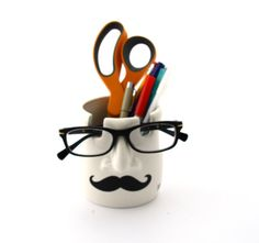 Ceramic pencil holder with space to hold your glasses features bold black mustache (or moustache) and the words YOURE SPECTACULAR. Great gift for co