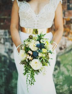 A bouquet of air plants and pearl succulents | http://www.poppyandmintfloral.com | Photo by Ariel Renae Photography