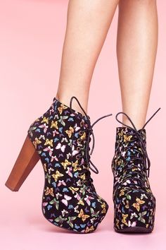 Lita Platform Boot - Butterfly    Towering black suede lace-up boots featuring a colorful butterfly print. Covered platform, chunky wooden heel. Genuine leather interior, non-slip sole. Perfect paired with a chunky knit and body-con skirt! By Jeffrey Campbell.