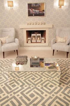 Love the metalics, mirror coffee table and lanterns in fireplace