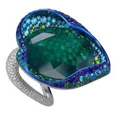 Flower ring by Chopard   Cannes Red Carpet Collection. Sapphires, emeralds, demantoids, amethysts, tsavorites, tourmaline parabias and diamonds.