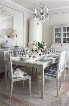 This image is an in inspiration of the Gustavian Era, belonging to A strong design element used is the use of light textures and light painted/grey furniture. The dining table is a typical gustavian carved design. Swedish Cottage, Swedish Decor, Swedish Style, Swedish House, Swedish Design, Nordic Style, Scandi Style, Swedish Interiors, Vibeke Design