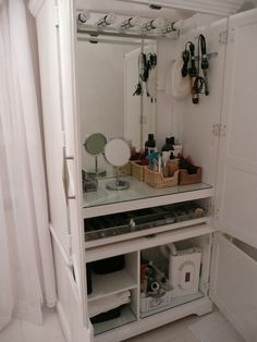 armoireconverted to makeup station a fresh coat of white paint a refurbished vanity light and wire baskets bought at a olies - Ensemble Vanite Armoire