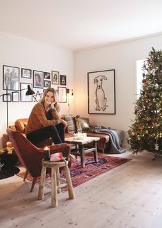 """TV/radio host and comedian Live Nelvik in her Christmas home featured in KK Living to journalist Hege Løvstad Toverud: """"I actually iron me bed sheets"""". Styling by Tone Kroken, photo by Yvonne Wilhelmsen Christmas Home, Bed Sheets, Tv Radio, Sweet Home, Couch, Pure Products, Living Room, Interior, Iron"""