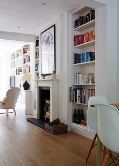 Books arranged by color in Isabel and George Blunden London renovation | Remodelista