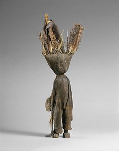 Senufo oracle figure (Wood, iron, bone, porcupine quills, feathers, commercially woven fiber, organic material)