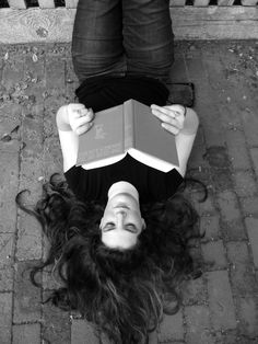Senior picture Girl posing with book