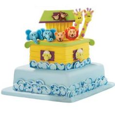 Ark Adventures Cake. All aboard for fun! Animal lovers of all ages will love this boatful of fondant critters floating atop a sea.
