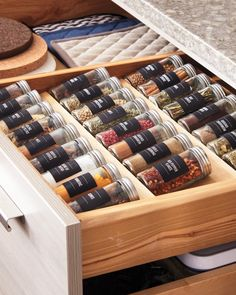 Don't let your spice collection crowd your counter space. Dedicate a drawer especially for your spices to save room while you're cooking. Use clearly legible labels to make them easy to find. The special pullout rack comfortably fits your spice bottles inside drawers and cabinets.