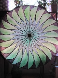 Looking to paint the gray parasols I purchased similar to this.    Fan Theme - Hand Painted Paper Parasol. $80.00, via Etsy.
