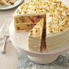 Cranberry Layer Cake Recipe -I adapted a Bundt cake recipe to create this layer cake. Cranberries, walnuts and homemade frosting make it taste so delicious that you'd never guess it starts with a convenient cake mix. —Sandy Burkett, Galena, Ohio