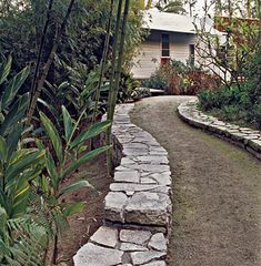 For the walk leading to the Hogan-Mayo house, concrete slabs from a dump were shaped and dry-fitted into a rhythmic pathway border according to a plan by landscape architect Steve Adams. His resurrected concrete is re-born in the hands of a master mason, and as a symbol of good design and innovation, is the perfect place to close the story of concrete at home.