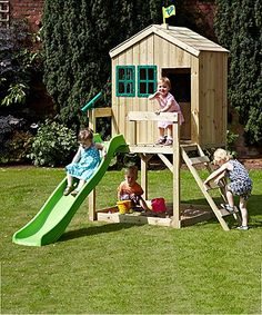 The TP Forest Cottage is a gorgeous wooden playhouse, complete with veranda, integral sandpit and wavy slide.
