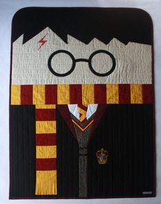 In dreams, we enter a world that's entirely our own. -- Albus Dumbledore  Harry Potter patchwork and applique baby quilt with embroidered Gryffindor