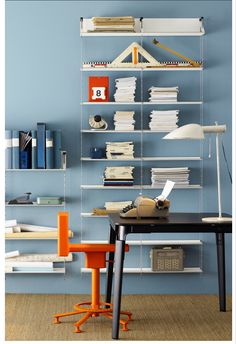 orange chair and light bookshelves String Shelf, String System, Sweet Home, Scandinavia Design, Shelving Systems, Danish Furniture, Swedish Design, Renting A House, Your Space