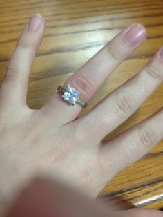 This simple square diamond engagement ring is this ring that cecily wears claiming that Algernon give her this promise ring