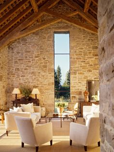 one fabulous window in what appears to be a stone barn.