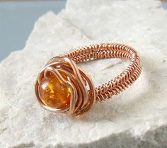 Amber and copper ring