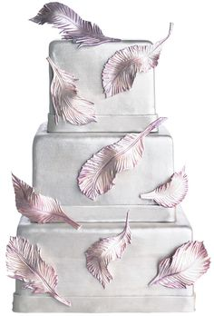 Feather embellished wedding cake