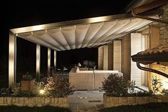 Outdoor Canopy and Pergola by Corradi Photo 6. (I like this idea for the guest wing of the new house after we extend the flagstone surface and add a french door facing the pool. dcm)