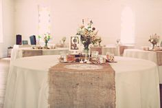 Rustic reception tables with burlap runners, by La Fleur Vintage