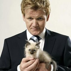 Nothing better than a sexy man holding a kitten....