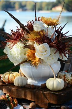 Fall flower arrangement centerpiece with roses, hydrangeas, mums and feathers | ©homeiswheretheboatis.net #fall #tablescape #alfresco #flowers #feathers Diy Summer Flower Arrangements, Fall Arrangements, Floral Centerpieces, Hydrangea Flower, Hydrangeas, Deco Floral, Floral Design, Autumn Table, Fall Flowers