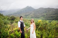 Sea Light Studios - Hawaii Photographers - Posed wedding photo of bride and groom with mountain backdrop