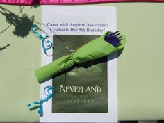 "Peter Pan Passport to Neverland.  Close-up of the ""passport.""  The pages of the passport contained quotes from Peter Pan, a place for the children to write their names and ages, and a list of the Neverland places in the yard (Lost Boys Camp, Pixie Hollow, Pirate's Cove, Peter Pan's Pizzeria)."