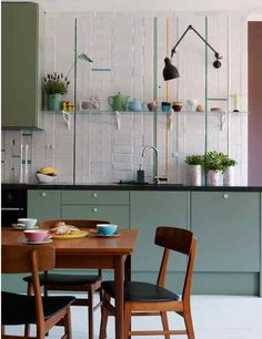 The kitchen in Stockholm from Isabella (Dos Family). I love the tiles and colours.