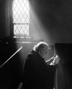 Mrs. Emma Robinson prays at Parkside Methodist Church, 1944 - by A. Aubrey Bodine (1906 -1970), USA