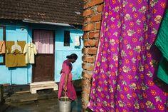 Alex Webb - INDIA. Fort Kochi. 2014. Aorund town in morning. Chinese fishing nets. Mulsim quarter.