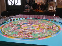 Sand Mandala from the  Asian Art Museum, San Francisco : The Sand Mandala is a Tibetan Buddhist tradition involving the creation and destruction of mandalas made from colored sand. A sand mandala is ritualistically destroyed once it has been completed and its accompanying ceremonies and viewing are finished to symbolize the Buddhist doctrinal belief in the transitory nature of material life.