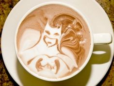 batman latte art! @Christy Polek Polek Polek DeuBuque I'm going to learn how to do this for you! haha.