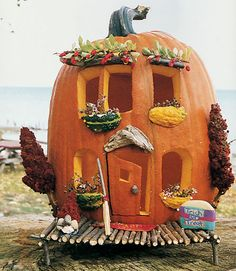 House Pumpkin:   Kim Ludwiczak and Renee Wisniewski of Livonia and Madison Heights, MI, added gourd-and-berry window boxes. Read more: Pumpkin Carving Ideas - Pumpkin Carving Designs and Pictures - Good Housekeeping