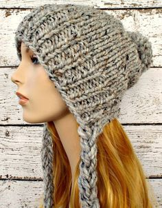 Knitting Pattern for Slouchy Earflap Hat - The Charlotte Beanie is a quick knit using only one skein of yarn and can easily be made in one evening. It's a cozy, slightly slouchy, split brim hat with long braided ties. tba quick one skein super bulky                                                                                                                                                                                 More