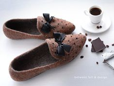 These cozy ballet flats are specially handcrafted to hug your feet just right for maximum relaxation. You can bring the comfort of your home wherever you go – they are enough stylish! Felted shoes for the home are made of 100% of sheep wool and decorated with bows. Indoor Slippers