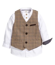 Set with a shirt and vest. Collarless oxford-weave shirt in with a contrasting color inside of cuffs. Vest in checked woven fabric with a chest pocket and front pockets. Back section in lining fabric. Lined.