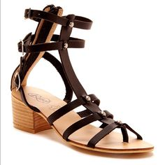 """Modern Rebel Lunamoon Sandal Brand new never worn. Sizing: True to size.  - Thong toe - Multi-strap detail with buckle and studded accent - Back zip closure - Stacked heel - Approx. 6"""" shaft height, 11"""" opening circumference - Approx. 2"""" heel height - Imported Materials: Leather upper, manmade sole Modern Rebel Shoes Sandals"""