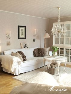Instead of White Couch - how about Cream/White/Greige Throws, wall hangings and pillows!