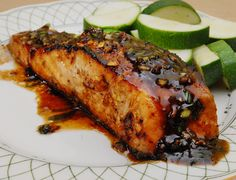 Maple-Glazed Salmon    2 salmon steaks cut in half skin on  1/4 cup pure maple syrup  2 tbsp soy sauce  3 tbsp fresh ginger minced  1-2 green onions diced fine  1 tbsp butter