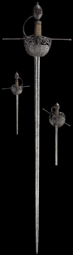 "Spanish Cup-hilt Rapier Dated: 17th century Measurements: length 112 cm Signed ""JULIAN GARCIA."""