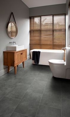 bathroom featuring secura pur luxury vinyl sheet flooring in plymouth slate