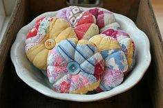 Quilt piece pincushions. So easy--you don't even need a pattern! I love the bright colors all mixed together.