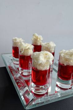 Cosmo Jello shots!  Cranberry Jelly Mix,Vodka, Water  Fresh Raspberries,Vanilla Pashmak Fairy Floss