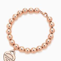 Return to Tiffany® small heart tag in 18k rose gold on a bead bracelet, medium.