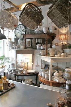 butik & annat - european shop - great idea of stacked tables for wall display