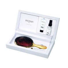 New Limited Edition - Luxurious Golden Spa Brush!   A high quality brush plays a vital role in the conditioning of your hair. This luxury hand made hair brush is 24 carat gold plated. The Golden Spa Brush cleans the hair, stimulates the scalp and increases the blood flow to the hair roots. This set includes chictravel sizes of Silk Perfume & Argan Moisturizing Elixir to keep your hair in optimum condition.