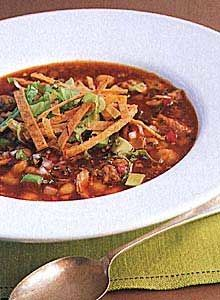 Pork and Hominy Stew with Red Chiles (Pozole Rojo) / Gourmet Studios